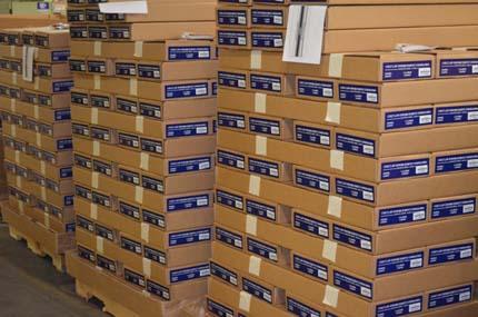 Уложенная в коробки и готовая к отправке продукция компании Кольт