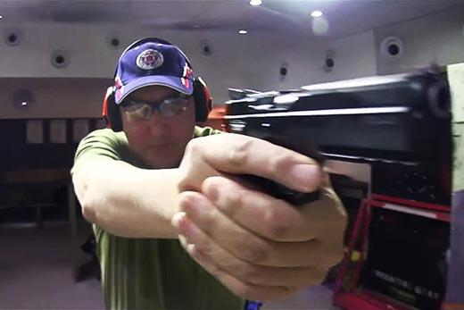 Рогозин с пистолетом